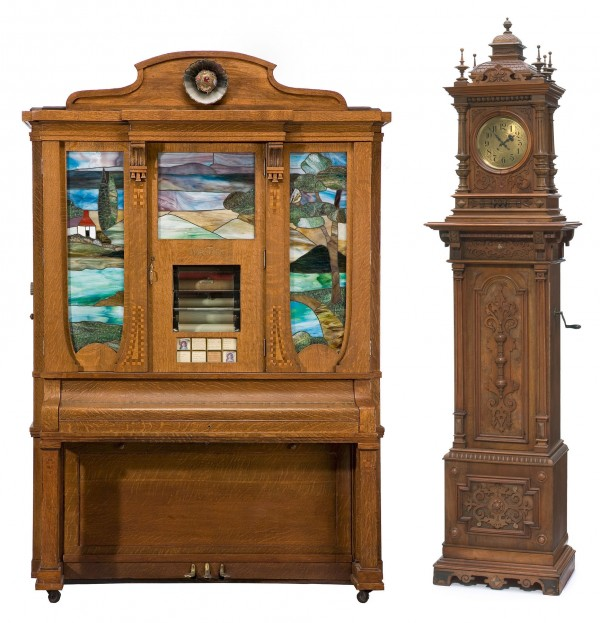 Both photos show mechanical music machines that sold recently at Bonhams Los Angeles. The one resembling a tall case clock sold for $8,125. The other, a Wurlitzer style orchestrion, brought $23,750.