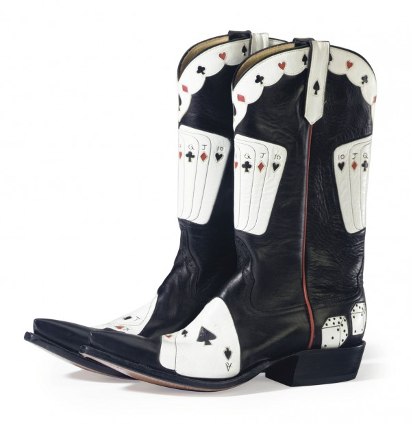Playing card cowboy boots from the collection of late actress Elizabeth Taylor brought $5,040 when her treasures sold recently at Christie's New York.