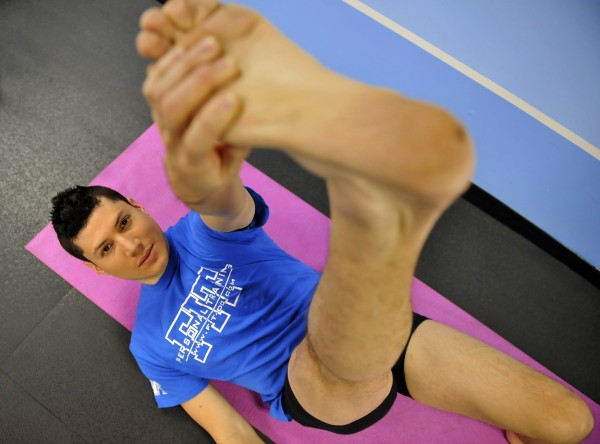Former professional dancer Alvaro Maldonado does a stretching exercise, part of his program to help men gain flexibility.