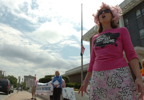 Lisa Savage of Solon, an activist with CODEPINK, speaks with the crowd during a protest in front of the Margaret Chase Smith Federal Building in Bangor on on July 29, 2011. Organized by the Peace and Justice Center of Eastern Maine, the protest called for cutting military spending as an alternative to proposed cuts to social services in order to reduce the deficit.