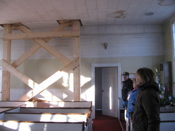 Members of the Troy Union Meeting House show the scaffolding that supports the steeple. The church is currently undertaking a major steeple restoration project and members hope that the listing on the National Register of Historic Places will make fundraising easier.