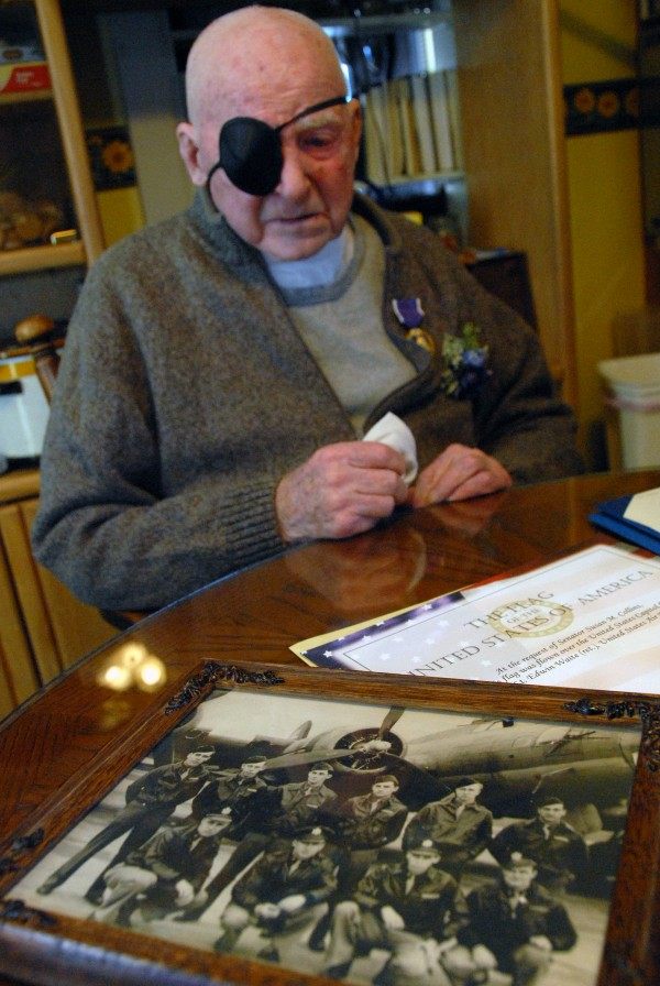 Retired U.S. Army Air Corps 1st Lieutenant Edwin Waite of Millinocket tells the story of his time with the 332nd Squadron of the 8th Air Force during World War II. Waite received a Purple Heart Medal from U.S. Sen. Susan Collins during a brief ceremony in his family's kitchen in Millinocket on Thursday, Jan. 19, 2012.
