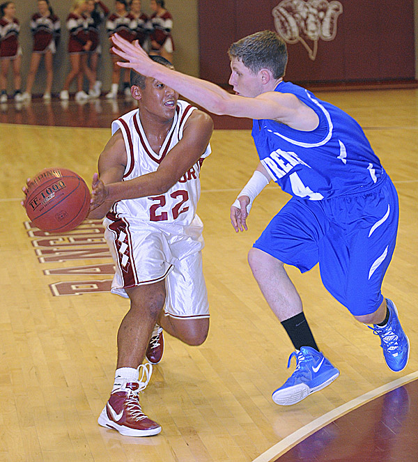 Bangor High School's Xavier Lewis (left) looks up to make a pass under pressure by Lawrence High School's Tim Dudley during the first half of the game in Bangor Tuesday evening.
