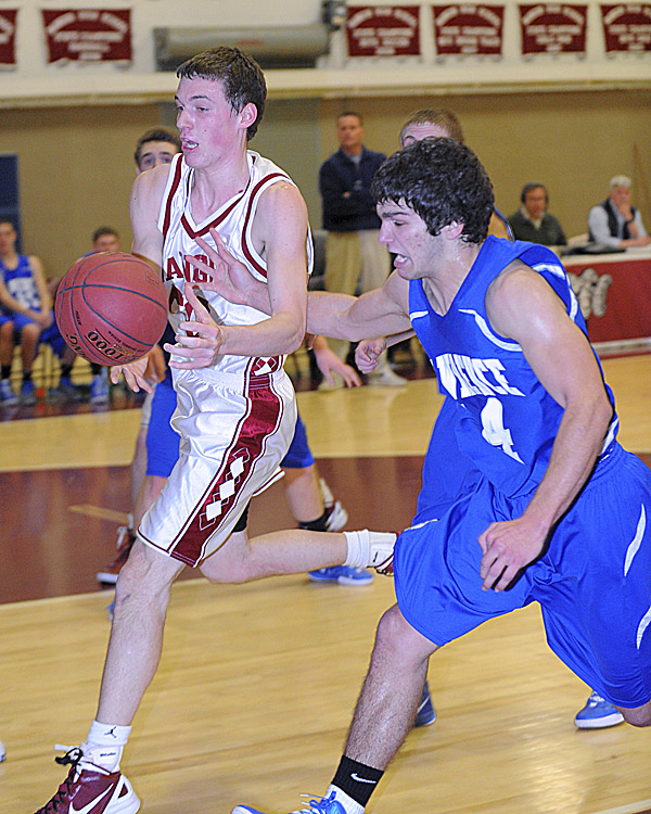 Bangor High School's Patrick Stewart (left) and Lawrence High School's Spencer Carey scramble for the ball during the first half of the game in Bangor Tuesday evening.