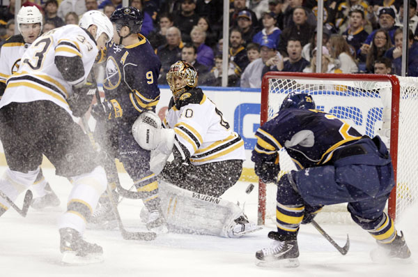 Buffalo Sabres' Jason Pominville (29) scores on Boston Bruins goalie Tuukka Rask, of Finland, during the first period of an NHL hockey game in Buffalo, N.Y., Wednesday, Feb. 8, 2012.