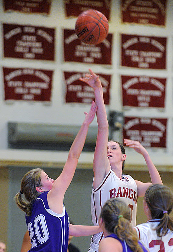 Bangor's Katie Brochu (right) puts up a shot over Hampden Academy's Helene Sherburne during a regular-season game in Bangor in December. Both Hampden and Bangor begin Eastern Maine Class A tourney play Friday at the Augusta Civic Center.