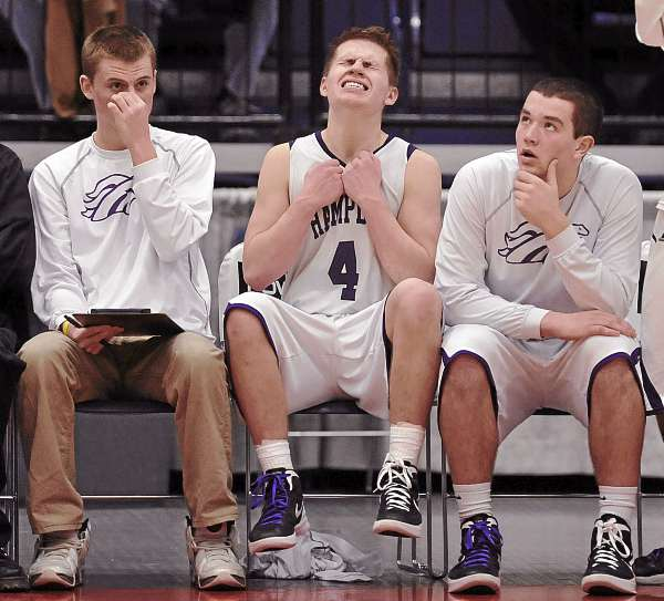 Hampden Academy's Cam McAllister, Christian McCue and Matthew Martin wait nervously in the final minute of their  Eastern Maine Class A final game in Augusta, Maine Friday, Feb. 24, 2012.