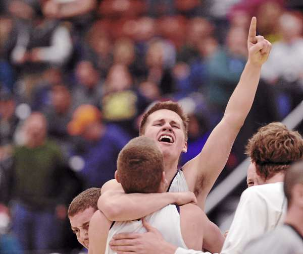 Hampden Academy's Christian McCue celebrates with teammates after defeating Mt. Blue 46-44 in their  Eastern Maine Class A final game in Augusta, Maine Friday, Feb. 24, 2012.