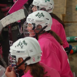 "Pictured here from top to bottom: Hebron Academy's Ashley Conrad '15, Sara Grover '12, and Chelsea Boucher '12 look on during Hebron's ""Pink in the Rink"" game versus New Hampton School on February 18."