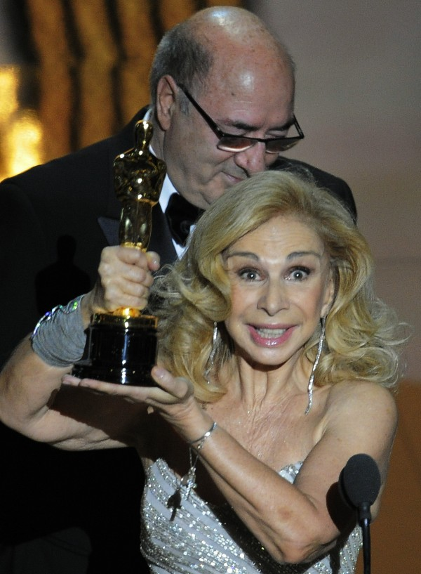 "Dante Ferretti and Francesca Lo Schiavo accept the Oscar for best art direction for ""Hugo"" during the 84th Academy Awards on Sunday, Feb. 26, 2012, in the Hollywood section of Los Angeles."