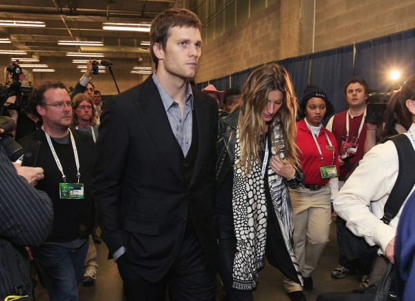 New England Patriots quarterback Tom Brady and his wife, Gisele Bundchen, leave the stadium after the Patriots' 21-17 loss to the New York Giants in the NFL Super Bowl XLVI football game, Sunday, Feb. 5, 2012, in Indianapolis.