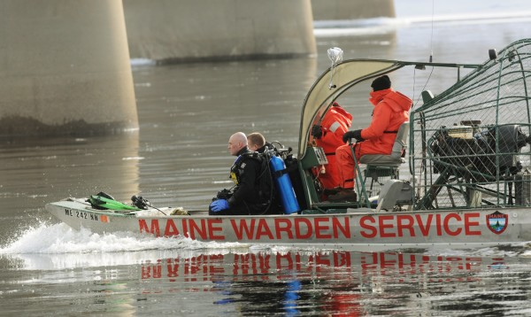 Members of the Maine Warden Service Dive Team prepare to enter the waters of the Kennebec River in Waterville on Friday, Feb. 3, to search for the body of Ayla Reynolds.