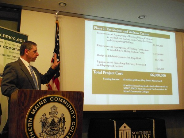 Tim Crowley, president of Northern Maine Community College, gestures toward a PowerPoint presentation on Wednesday, February 8, 2012, as the college announced a $5 million private donation to the college from Mary Barton Akeley Smith, a Presque Isle native.