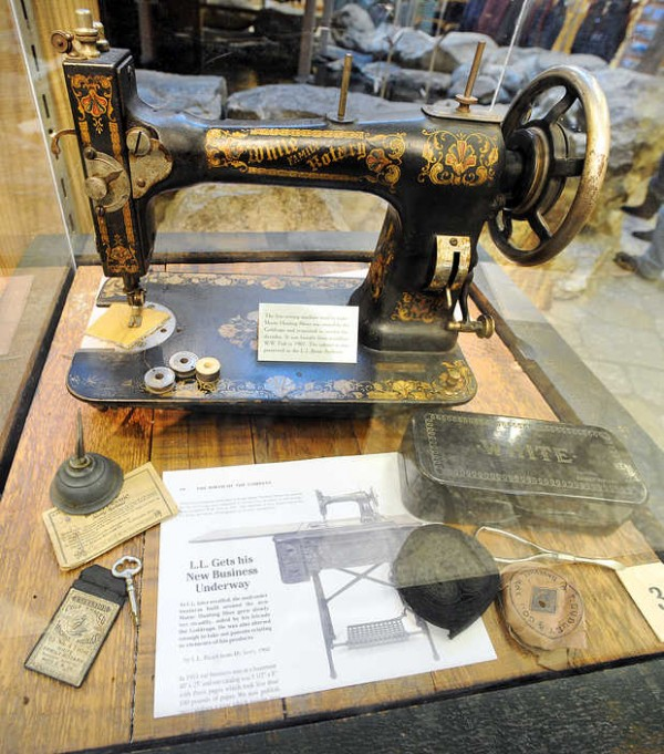 The sewing machine used to make the first pair of Bean boots is seen in this display cube, one of many throughout the store in Freeport featuring L.L. Bean products from the past.