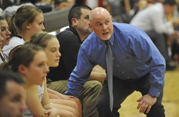 Brewer High School head coach Andy Nickerson keeps his eye on a Brewer rebound under the Bangor bucket during the first quarter of Tuesday night's Class A girls basketball prelim against Bangor High School at Brewer High School.