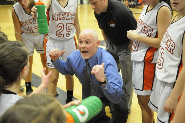 Brewer High School girls basketball head coach Andy Nickerson huddles with the Witches after the first quarter of Tuesday night's Class A girls basketball prelim against Bangor High School at Brewer High School.