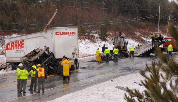 A tractor-trailer (left) and a Webber Energy Fuels propane tanker collided on Route 9 in Beddington on Wednesday. The drivers of both vehicles were taken to the hospital with minor injuries. The tractor caught on fire and was completely destoyed but the trailer was not burned. The propane tanker was not effected by the fire. The accident forced the closure of Route 9 for several hours.
