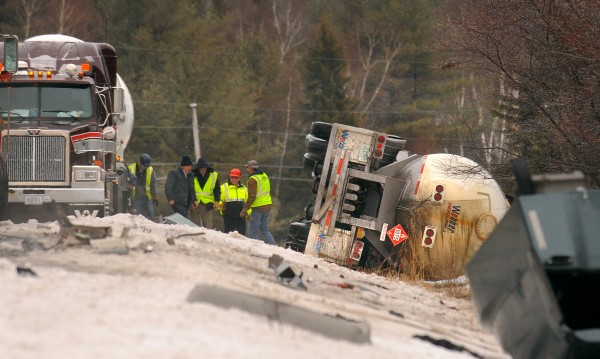 A Webber Energy Fuels propane tanker lays on it's side after it collided with a tractor-trailer on Route 9 in Beddington on Wednesday. The drivers of both vehicles were taken to the hospital with minor injuries. The tractor caught on fire and was completely destoyed but the trailer was not burned. The propane tanker was not effected by the fire. The accident forced the closure of Route 9 for several hours.