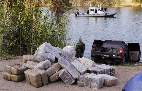 In this June 8, 2011, file photo U.S. Customs and Border Patrol and Texas Department of Public Safety seize 57 bundles of marijuana weighing more than 1,200 pound at the Texas border along the Rio Grande in Abram, Texas.