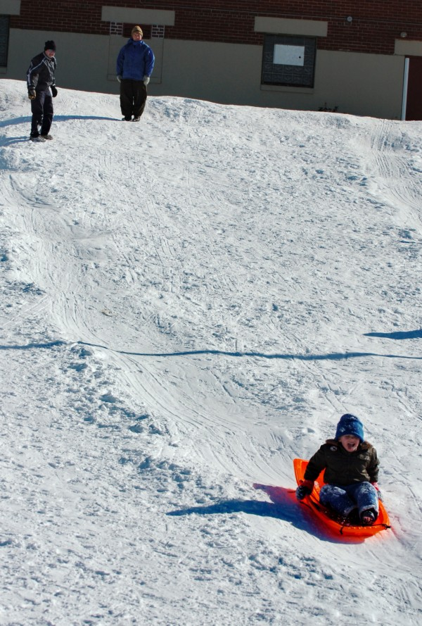 Aiden Dore, 5, sleds down the hill behind Brewer Auditorium under the watchful eye of his grandparents Gene and Jacki Kasper of Old Town in February 2009 during Winterfest. The city's 10th annual Winterfest is Friday, Feb. 17 and Saturday, Feb. 18.