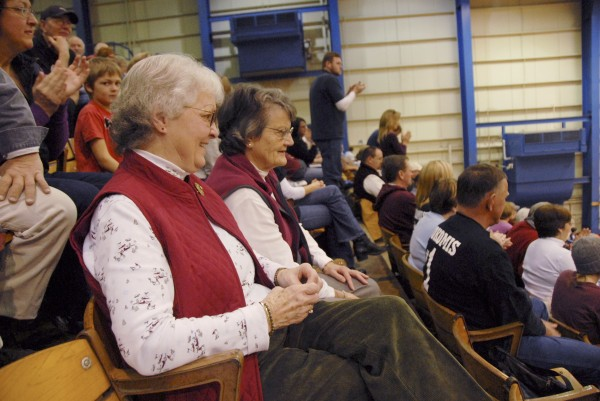 As the Nokomis and Medomak Valley girls' basketball teams play at the Bangor Auditorium on Saturday morning, Feb. 18, Joan Butler (left) and Faye Albert watch the game. Originally from Houlton, Butler and Albert moved to Bangor in 1974 and started attending tournament game soon afterwards. Dedicated Aroostook County team fans, they arrived early on Feb. 18 to get good seats prior to the Ellsworth-Presque Isle boys' game. Butler and Albert, who inadvertently wore the Nokomis school colors, found themselves surrounded by Nokomis fans for the day's first game.