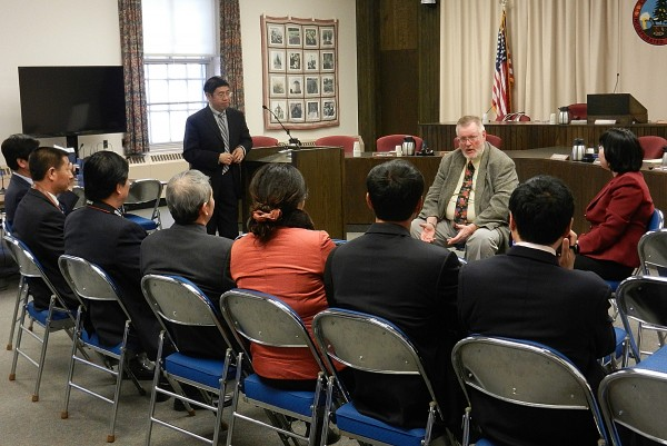 Former Bangor City councilor Gerry Palmer Jr. (seated, facing camera) meets with a Chinese delegation of school principals in city council chamber in Bangor Monday, Feb. 27, 2012.