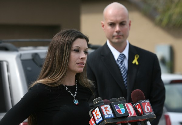 Tonya Perdomo, wife of missing firefighter Jerry Perdomo, talks to reporters during a press conference at the Perdomo home in Orange City, Fla., Monday, Feb. 27, 2012.