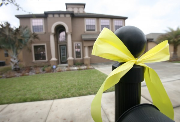 A yellow ribbon is tied on the mailbox outside Jerry Persomo's house, and on every black mailbox in the neighborhood on the street where Perdomo lives in Orange City, Fla., Monday, Feb. 27, 2012.