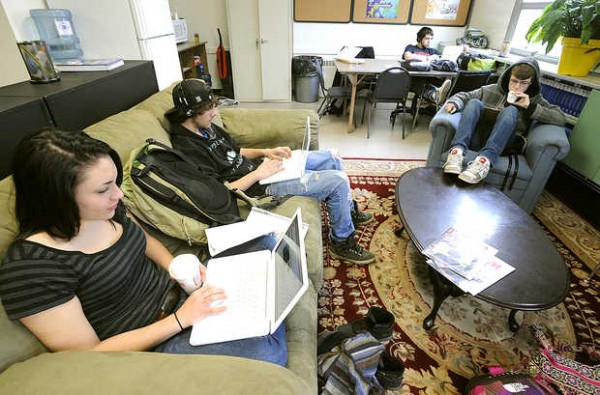 Edward Little High School students from left, Caroline Snowe, 17, Alex Stratton, 17, and Derek Caron, 18, work on assignments during the &quotEL PM&quot credit recovery program that helps students graduate on time.