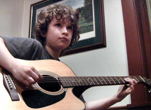 Justin Lindsay, 11, of Scarborough warms up prior to Monday night's open mic at Pedro O'Hara's in Lewiston.