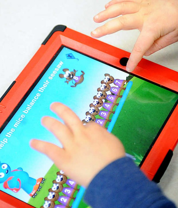 Keegan Olcott works on a counting application on an iPad in Susan Lemeshow's kindergarten class Wednesday morning.