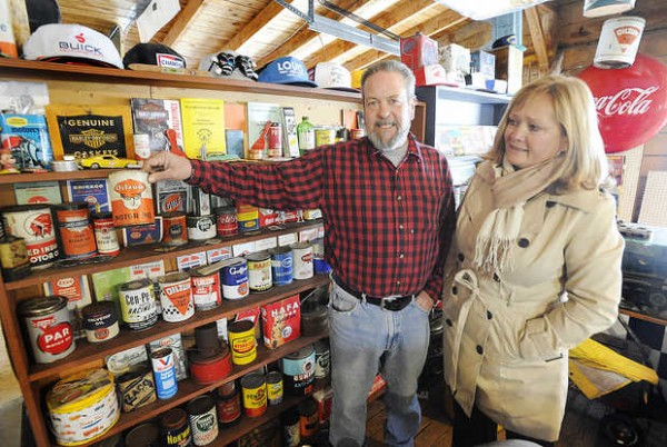 Jim and Kathy Harris of Lisbon Falls show their oil can collection that attracted the attention of Mike Wolfe and Frank Fritz of the History Channel's &quotAmerican Pickers&quot during a recent visit.