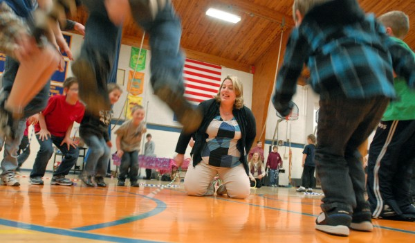 Glenburn School physical education teacher Heidi Thayer plays the jump rope game with kindergarteners and first graders. Glenburn joined with Veazie and Orono during the school consolidation process.