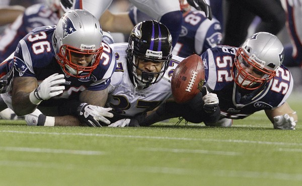 Baltimore Ravens' Emanuel Cook (37) grabs for a loose ball between New England Patriots' Lousaka Polite (36) and Dane Fletcher after it was fumbled by Patriots' Danny Woodhead on a kick return during the second half of the AFC championship NFL football game Sunday, Jan. 22, 2012, in Foxborough, Mass.