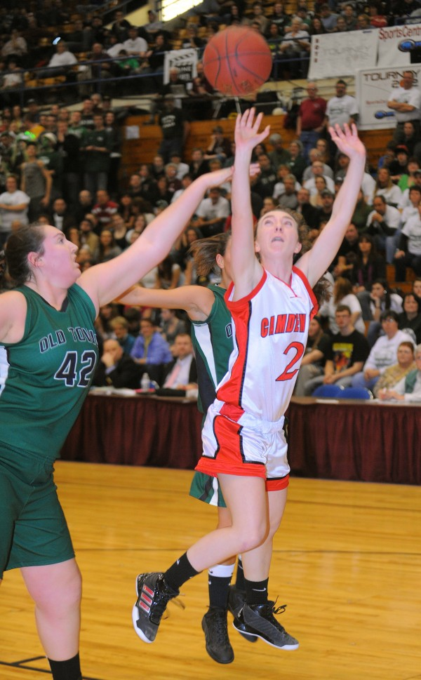 Camden Hills High School's Caroline Matteo (left) goes up for a shot over Old Town High School's Courtney Treadwell during the first half of a Class B quarterfinal at the Bangor Auditorium Friday evening.