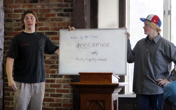 1:02 PM - Jamie Marshall, left, and Henry Townsend announce the word of the day during the daily school meeting after lunch at Carrabassett Valley Academy.