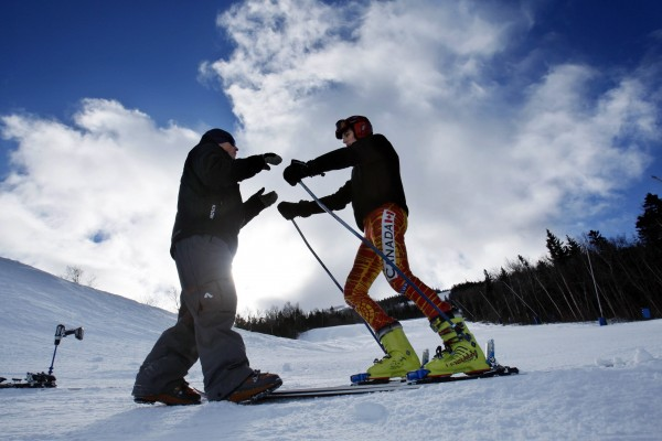 11:07 AM - Head alpine coach Doug Williams, left, works with racer Vincent Daigle, of St. Sauveur, Quebec, on the giant slalom course at Sugarloaf.
