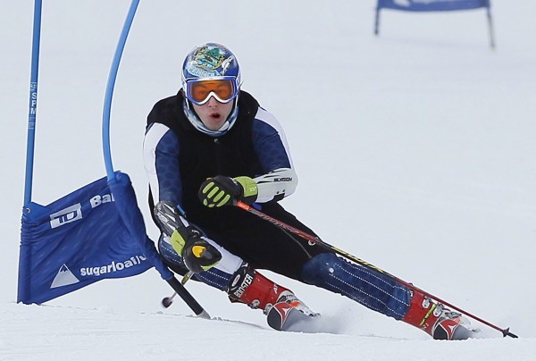 10:45 AM - Jamie Marshall, of Carrabassett Valley, hits a gate while training on the giant slalom course.