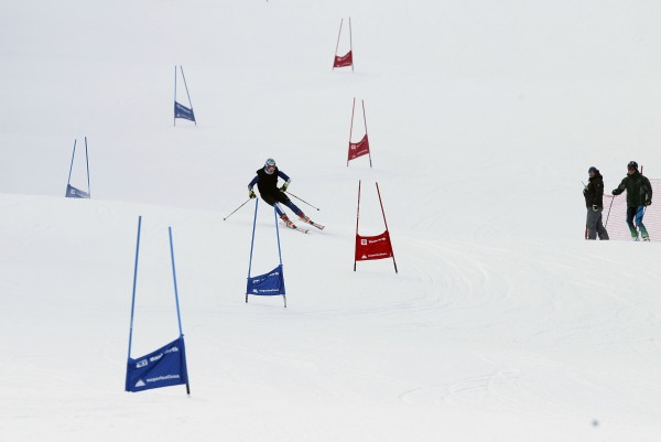 10:45 AM - Jamie Marshall heads into a turn on the giant slalom course as coaches look on at Sugarloaf, Tuesday, Feb. 7.