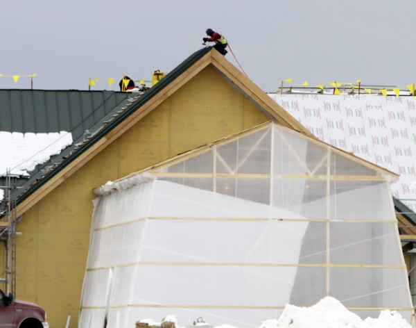 A construction worker continues building The Oxford Casino, which is under construction and is scheduled to open this summer, in Oxford, Maine, on Monday, Feb. 27, 2012.