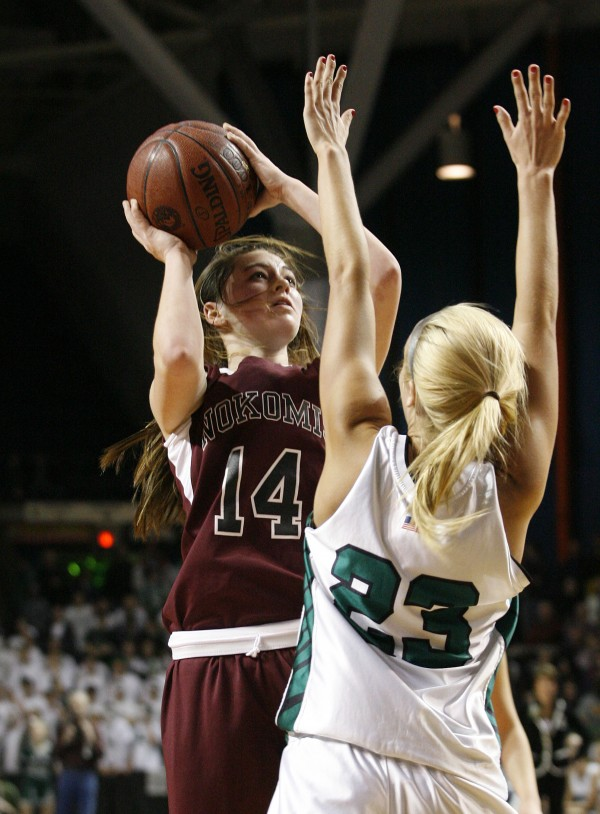 Marissa Shaw (14) of Nokomis of Newport shoots over Amanda Jordan of Leavitt of Turner Center during the state Class B girls basketball championship game at the Cumberland County Civic Center in Portland on March 4, 2011. Leavitt defeated the Warriors 49-37.