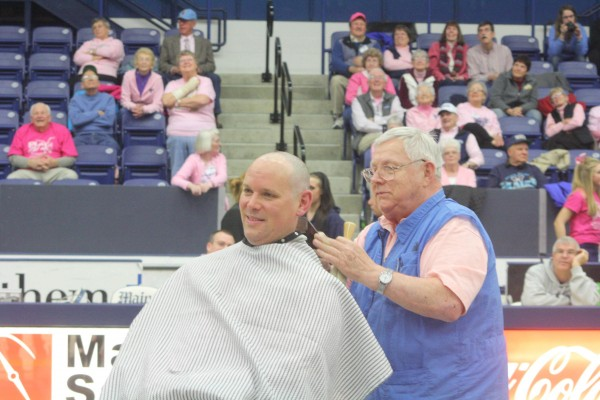 University of Maine women's basketball coach Richard Barron can't help but smile as Orono barber Erv Morrison finishes shaving his head after Wednesday night's game against Hartford at Alfond Arena in Orono. Barron promised to shave his head if UMaine fans donated $10,000 to the Kay Yow Foundation. UMaine surpassed the goal.