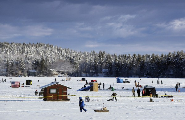 Fishermen take their positions during the Crystal Lake Ice Fishing Derby, Saturday, Feb. 25, 2012, in Gray. Proceeds from the derby support Maine's military, the Department of Inland Fisheries and Wildlife and local schools.