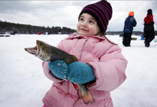 Autumn Burnell, 4, of Hollis outfished many of the adults, landing a half-pound brook trout during the Crystal Lake Ice Fishing Derby, Saturday, Feb. 25, 2012, in Gray.