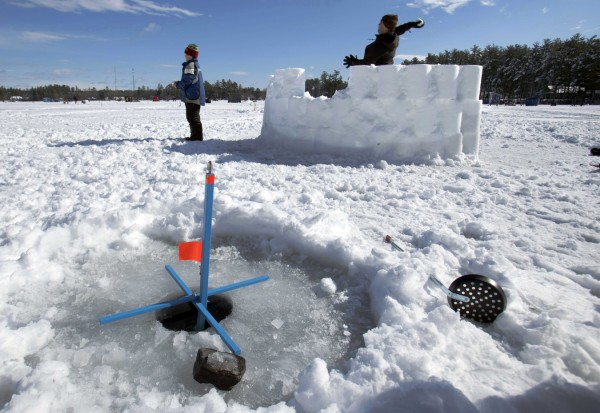 The fishing action was slow, so Cooper Fochler and his father, Rick, of Yarmouth, built a fort and challenged friends to a snowball fight during the Crystal Lake Ice Fishing Derby, Saturday, Feb. 25, 2012, in Gray.