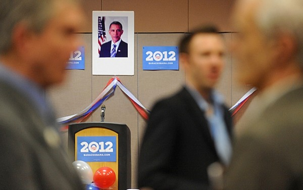 Democratic candidates and their supporters gather for the Penobscot County Democratic Caucus Breakfast at the Bangor Civic Center on Sunday, Feb. 26, 2012. In the background, above a lectern, is a poster image of President Barack Obama.