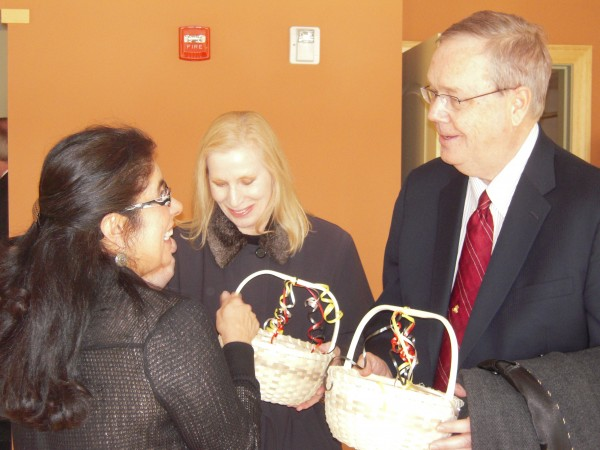 Maliseet Chief Brenda Commander (left) of the Houlton Band presents native baskets made by tribe member Bill Tomah to officials of the U.S. Department of Agriculture Rural Development in gratitude for their participation in the opening of a new multifamily housing facility on tribal land Feb. 9. Under secretary Dallas Tonsager (right) came from Washington, D.C., for the ceremony and State Director Virginia Manuel came from Bangor.