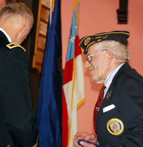 Edward Brown, 92, of Dennysville was among veterans honored at a veterans recognition ceremony Thursday in Calais. Brown was presented with a Maine Silver Star by Major General Bill Libby (left), the adjutant general of the Maine National Guard, for his service during World War II, which included 10 months as a prisoner of war in Germany.