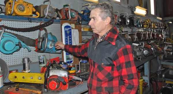Louis Pelletier Jr. spends some time showing off his more than 350 chainsaws in his collection. A former chainsaw dealer and repairman, Pelletier can trace the evolution, history and modifications to just about every chainsaw make and model used in Maine woods.