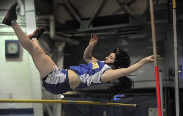 Margaret Pierce of Hermon just grazes the cross bar which was set to 7 feet in the girls pole vault event of the PVC Eastern Maine Indoor Track League Championship at the University of Maine in Orono on Saturday, Feb. 11, 2012.